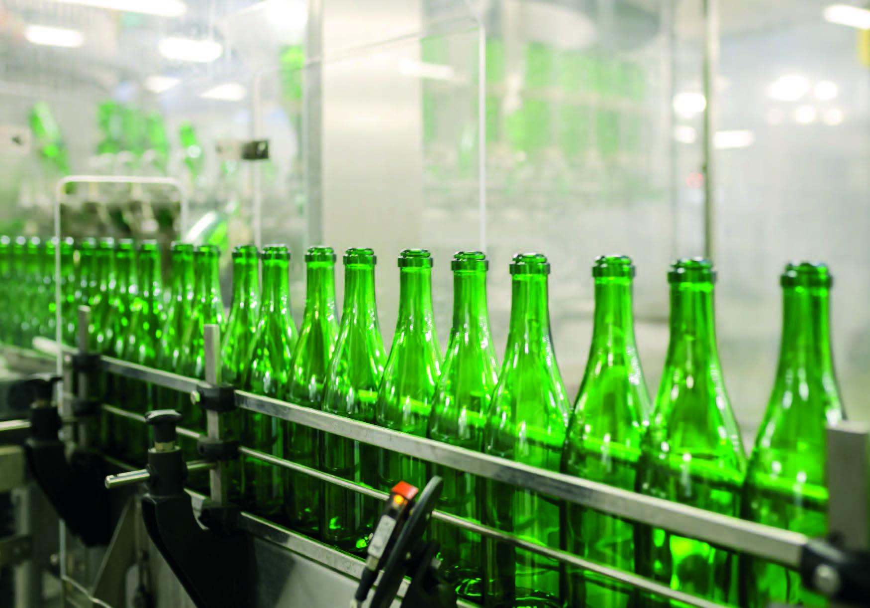 Bottles being scanned by diemetric sensor